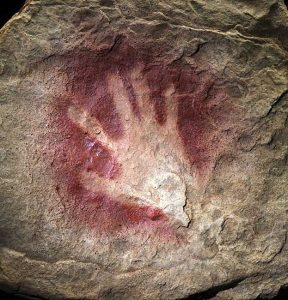 paleolithic handprint in a cave
